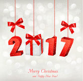 Christmas background with a 2017 and a gift box. Vector Stock Photography