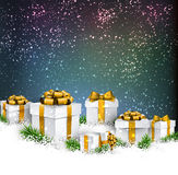 Christmas background with gift boxes. Abstract christmas background with fir branches and realistic gift boxes. Vector illustration Stock Image