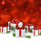 Christmas background with gift boxes. Abstract christmas background with fir branches and realistic gift boxes. Vector illustration Stock Photo