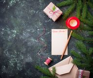 Christmas background. Gift boxes, letter and candle. Top view Stock Images