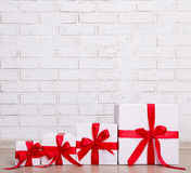Christmas background - gift boxes over brick wall Royalty Free Stock Photography