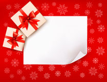 Christmas background with gift boxes and red bow. Vector illustration Royalty Free Stock Image