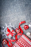 Christmas background with gift boxes, ribbons, paper snowflakes and red decorations Stock Image