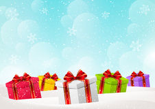 Christmas background with gift boxes. On snow Royalty Free Stock Photography