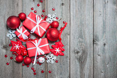 Christmas background. Gift boxes and snowflakes on wooden background Stock Photography