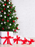 Christmas background - gift boxes under decorated christmas tree Stock Photo