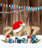Christmas background with a 2017 and a gift boxes. Vector Stock Image