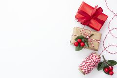 Free Christmas Background. Gift Boxes Wraped In Craft Paper Over White Background. Wraping Gift Boxes. Top View. Copy Space Royalty Free Stock Photos - 161014258