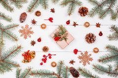 Christmas background with Christmas gift, fir branches, pine cones, snowflakes, red decorations. Xmas and Happy New Year compositi Stock Photos