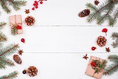 Christmas background with Christmas gift, fir branches, pine cones, snowflakes, red decorations. Xmas and Happy New Year Royalty Free Stock Image