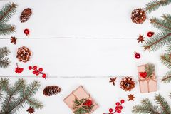 Christmas background with Christmas gift, fir branches, pine cones, snowflakes, red decorations. Xmas and Happy New Year Royalty Free Stock Photography