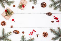 Christmas background with Christmas gift, fir branches, pine cones, snowflakes, red decorations. Xmas and Happy New Year Royalty Free Stock Photo