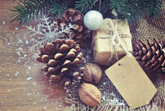 Christmas background with  gift, fir tree cone Royalty Free Stock Photo