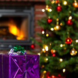 Christmas background with gift in foreground Stock Photography