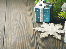 Christmas background with gift and snow flake Royalty Free Stock Photos