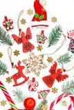 Christmas background with a santa hat, gifts, candy, New Year decorations, toys, branch of Xmas tree on a white background. stock photography