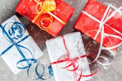 Christmas background with gifts. Christmas background with decorated gifts. Gray background, snow effect, Top view copy space Royalty Free Stock Photography