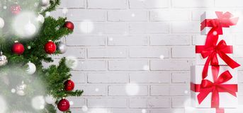 Christmas background - gifts and christmas tree over brick wall Stock Photography
