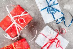 Christmas background with gifts. Christmas background with decorated gifts. Gray background, snow effect, Top view Stock Photo