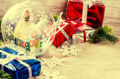 Christmas background with gifts and the toy in the form of house Stock Photography