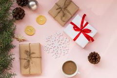 Christmas background with gifts and Christmas tree tea cup fruit royalty free stock images