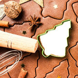 Christmas background with Gingerbread baking dough, cookie cutte Stock Images