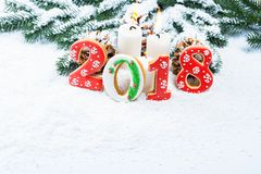 Christmas background with gingerbread cookie 2018, candle, snow. And branches of a Christmas tree. Free space stock images