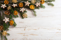 Christmas background with gingerbread cookies and dried orange s Stock Image