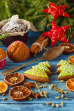 Christmas background with gingerbread cookies, fir wreath, dried Stock Image