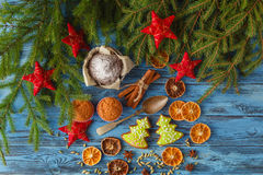 Christmas background with gingerbread cookies, fir wreath, dried Royalty Free Stock Photography