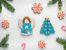 Christmas background with gingerbread cookies  and green fir tre Royalty Free Stock Image