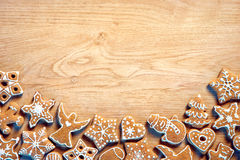 Christmas background with Gingerbread cookies on wooden table Royalty Free Stock Photography