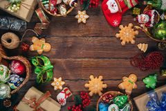 Christmas background with gifts, toys, ball, tree branches, New Year decor on old wooden background. Christmas  background with gingerbread, decorations and Stock Images