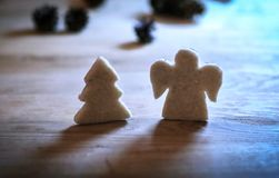 .gingerbread figures Christmas tree and an angel on the wooden t. Christmas background.gingerbread figures Christmas tree and an angel on the wooden table Stock Photo