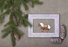 Christmas background with gingerbread in the form of a horse in Stock Photos