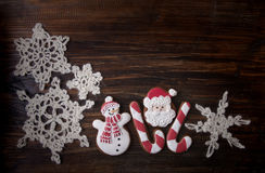 Christmas background with gingerbread in the form a snowman and Royalty Free Stock Images
