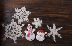 Christmas background with gingerbread in the form a snowman and Royalty Free Stock Photo