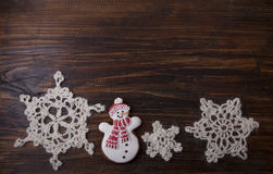 Christmas background with gingerbread in the form a snowman Stock Image
