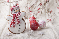 Christmas background with gingerbread in the form a snowman Royalty Free Stock Photos