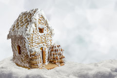 Christmas background gingerbread house in snow Royalty Free Stock Image