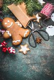 Christmas background with Gingerbread man cookie , festive gift boxen and scissors, top view Royalty Free Stock Photos