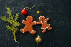 Christmas background. Gingerbread man and girl cookies, fir tree Royalty Free Stock Photography