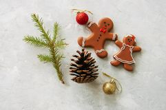 Christmas background. Gingerbread man and girl cookies, fir tree Royalty Free Stock Images