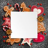 Christmas background with gingerbread and rustic ornaments stock images