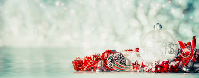 Christmas background with glass balls and red festive decoration at winter bokeh background, front view. Banner stock images