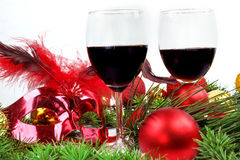Christmas background with glasses of wine and ornaments Royalty Free Stock Photos