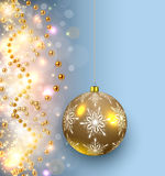 Christmas background glittering lights. And shiny gold glass ball Royalty Free Stock Image