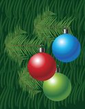 Christmas background with globes and pine leaves Stock Photography