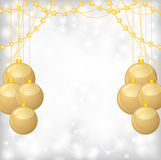 Christmas background with gold balls and gold beads garland Stock Photos