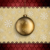 Christmas background. Gold bauble, white snowflakes and red patterned background Royalty Free Stock Photography